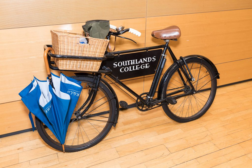 "old bicycle with sign saying ""Southlands College"""