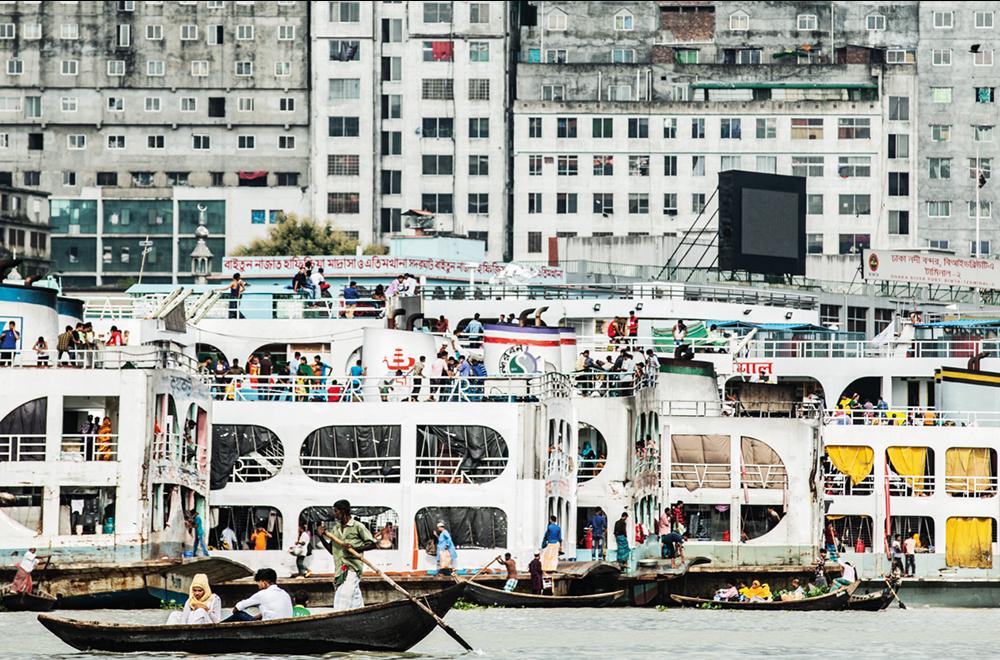 Boats and multi-storey buildings in Dhaka, Bangladesh