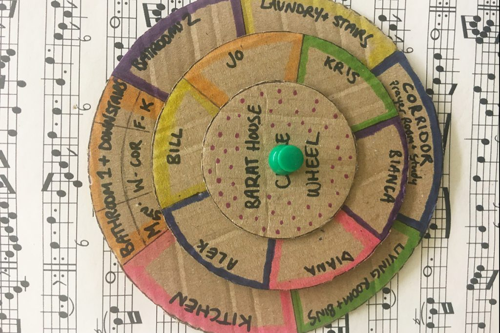 cardboard wheel listing names and chores